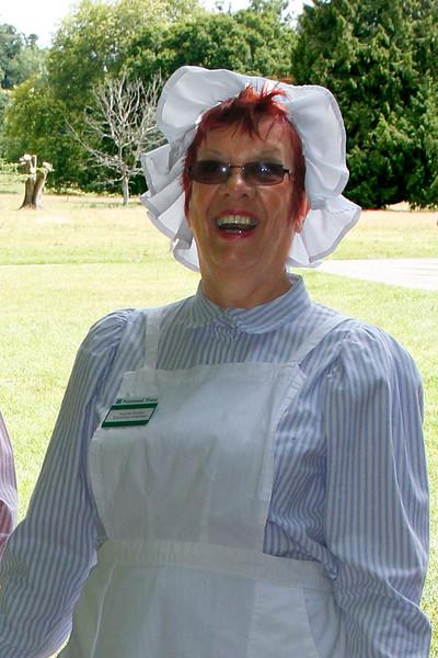 Angela dressed as a laundry maid.