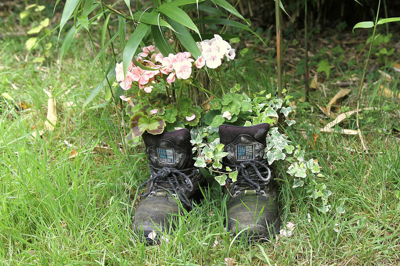 A pair of gardeners boots left for decoration.