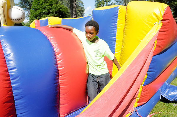 Don Knight/The Herald Bulletin<br /> Daniel Morton, 10, plays on an inflatable obstacle course during the Anderson Black Expo Summer Fest on Saturday.