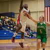 While attempting a layup in the fourth quarter Anderson senior Taylor Potts is fouled by New Castle defender Samntha Underwood. Anderson High School girls defeat New Castle 61 to 26 in the second round of Sectional #9 at Greenfield-Central High School Friday, February 8, 2013. Anderson advances to play Connorsville in the finals Saturday at 7:30 p.m. Photo by Richard Sitler