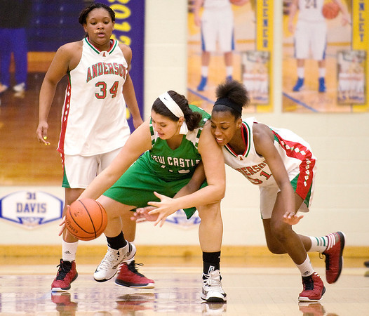 Anderson's Dabriona Williams attempts to steal the ball from New Castle's Zoe Curtis in the second quarter. Anderson High School girls compete against New Castle in the second round of Sectional #9 at Greenfield-Central High School Friday, February 8, 2013. Photo by Richard Sitler