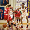 Anderson's Dabriona Williams shouts as she defends Connersville's Taylor Stephen who passes the ball behind her back. Anderson fell to Connersville in the final of sectional #9 at Greenfield-Central Saturday, February 9, 2013. Photo by Richard Sitler