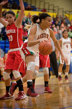 Anderson's Chelsea Bentley gets past Connersville defender Ashlee Wiley as she drives to the basket. Anderson fell to Connersville in the final of sectional #9 at Greenfield-Central Saturday, February 9, 2013. Photo by Richard Sitler
