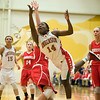 Anderson's Samia Carter throws up a shot as she drives to the basket. Anderson fell to Connersville in the final of sectional #9 at Greenfield-Central Saturday, February 9, 2013. Photo by Richard Sitler
