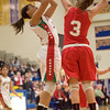 Anderson's Chelsea Bentley attempts a shot along the baseline as she is guarded by Connersville's Kenzie Weston. Anderson fell to Connersville in the final of sectional #9 at Greenfield-Central Saturday, February 9, 2013. Photo by Richard Sitler