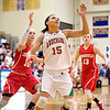 Anderson junior Chelsea Bentley tries to track down a rebound ahead of Connersville's Tierra Huntsman. Anderson fell to Connersville in the final of sectional #9 at Greenfield-Central Saturday, February 9, 2013. Photo by Richard Sitler