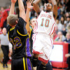 Don Knight / The Herald Bulletin<br /> Anderson's Kenya Wilkerson shoots as he is guarded by Guerin Catholic's Cris Burrough and Matt Holba on Friday.