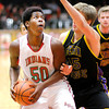 Don Knight / The Herald Bulletin<br /> Anderson's Kobe Clay looks to shoot from the low post as he is guarded by  Guerin Catholic's Aaron Brennan on Friday.