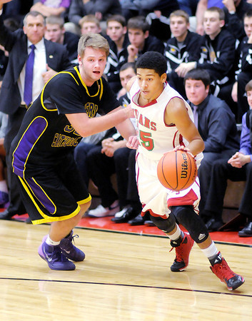 Don Knight / The Herald Bulletin<br /> Anderson's Thomas Wells gets a step on Guerin Catholic's Cris Burrough as he dirves to the basket on Friday.