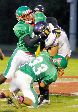 Don Knight/The Herald Bulletin<br /> Anderson's Bryant White and Zach Amos sack Marion quarterback Niko Trevino on Friday.