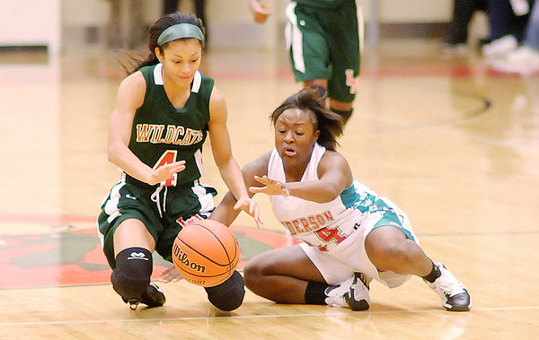 Don Knight/The Herald Bulletin<br /> Anderson's Samia Carter and Lawrence North's Ana Owens scramble for a loose ball as the Indians hosted the Wildcats on Wednesday.