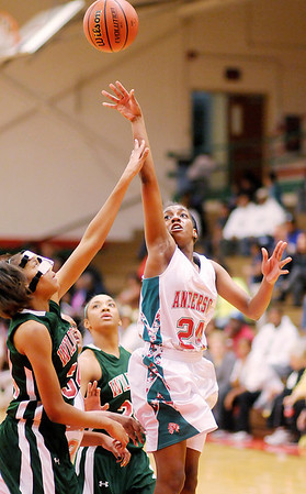 Don Knight/The Herald Bulletin<br /> Anderson's Dabriona Williams shoots as she is guarded by Lawrence North's Destiny Washington as the Indians hosted the Wildcats on Wednesday.