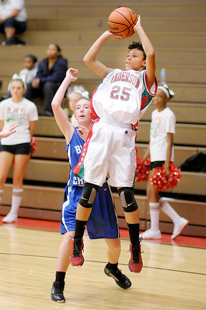 Anderson's Darien Thompson shoots as the Indians hosted the Bishop Chatard Trojans on Saturday.