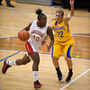 Anderson's Jacie Dickerson attempts a layup on a fast break as she is defended by Greenfield-Central's Emily Koers. Anderson High School faces Greenfield-Central High School in the first round of girl's basketball sectional #9 at Greenfield-Central High School Monday, February 5, 2013. Photo by Richard Sitler