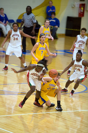 Taylor Potts and a Greenfield-Central player collide as they chase a loose ball. Anderson High School faces Greenfield-Central High School in the first round of girl's basketball sectional #9 at Greenfield-Central High School Monday, February 5, 2013. Photo by Richard Sitler