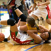 While going after a loose ball Anderson's Chelsea Bentley has a Greenfield-Central player land on top of her. Anderson High School faces Greenfield-Central High School in the first round of girl's basketball sectional #9 at Greenfield-Central High School Monday, February 5, 2013. Photo by Richard Sitler