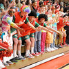 Anderson High School students great the Indians as they run on the court as the Indians hosted Kokomo on Friday.