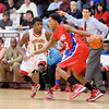 Anderson's Chris Lemon guards Kokomo's Mykal Cox as the Indians hosted the Wildkats on Friday.