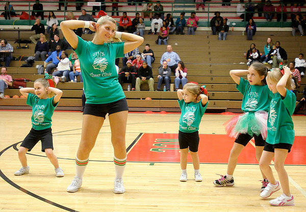 Anderson High School's cheer leaders held a cheer clinic on Saturday for girls ages 5 to 14. The 34 participants were invited back to perform at half time and cheer during Anderson's game against Indianapolis Manual.