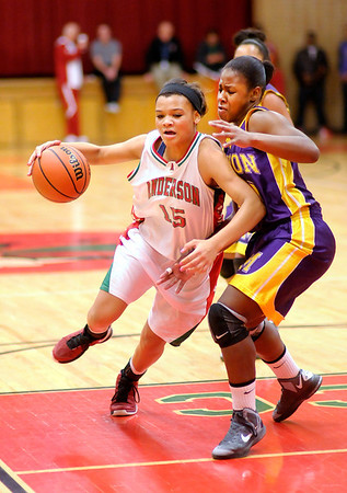 Anderson's Chelsea Bentley drives into the paint against Marion's Shalay Stevens on Saturday.