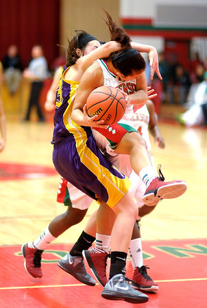 Marion's Julia Cardwell fouls Anderson's Savanah Jones as she was driving for a layup on Saturday.