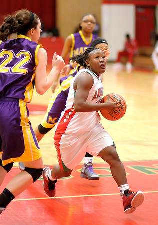 Anderson's Samia Carter drives to the basket as the Indians hosted the Marion Giants on Saturday.