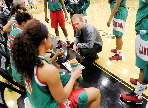 Anderson coach Chad Cook talks to his starting five as the Indians faced the Mt. Vernon Marauders on Tuesday.