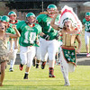 Don Knight/The Herald Bulletin<br /> Maiden Kaira Jackson and mascot Hamilton Smith lead the Indians onto the field as Anderson hosted Richmond on Friday.