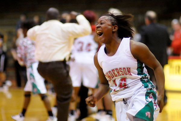 Don Knight / The Herald Bulletin<br /> Anderson's Samia Carter celebrates after the final buzzer of Anderson's 43-41 win over Mt. Vernon to claim the sectional championship at Connersville on Saturday.