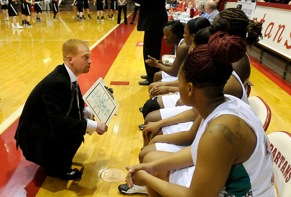 Don Knight / The Herald Bulletin<br /> Anderson coach Chad Cook talks to his team before tip off as the Indians faced Mt. Vernon in the sectional championship at Connersville on Saturday.