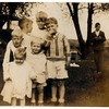 The same 4 children as the previous photo plus 3 more.<br /> <br /> Who is this?<br /> <br /> Laurie thinks Jeanne, Spencer and Stan are not in this photo.<br /> <br /> Dave wonders if maybe Jeanne, Spencer and Stan are in photo?<br /> <br /> This photo was with a group of Fredine photos, so this is maybe Fredine cousins of Jeanne's.