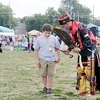 Don Knight/The Herald Bulletin<br /> Jim Hammon from Arkansas City, Ark. gives Tyler Ennesser, 8, a few dancing tips during the Andersontown Powwow on Saturday.