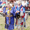Don Knight/The Herald Bulletin<br /> Head Lady Dancer Tonya Blackowl Moore and Head Man Dancer Ed de Torres dance together during a rabbit dance at the Andersontown Powwow on Saturday.