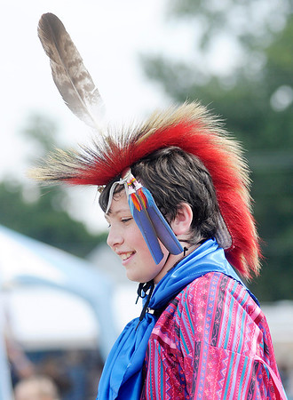 Don Knight/The Herald Bulletin<br /> Storm Skeel, 13, from Kennard dances during the mens dance during the Andersontown Powwow on Saturday.
