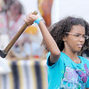 "Don Knight/The Herald Bulletin<br /> Hannah Bowen, 9, throws a tomahawk after receiving some instruction from ""Hawk Man"" Steve Witt during the Andersontown Powwow on Saturday."