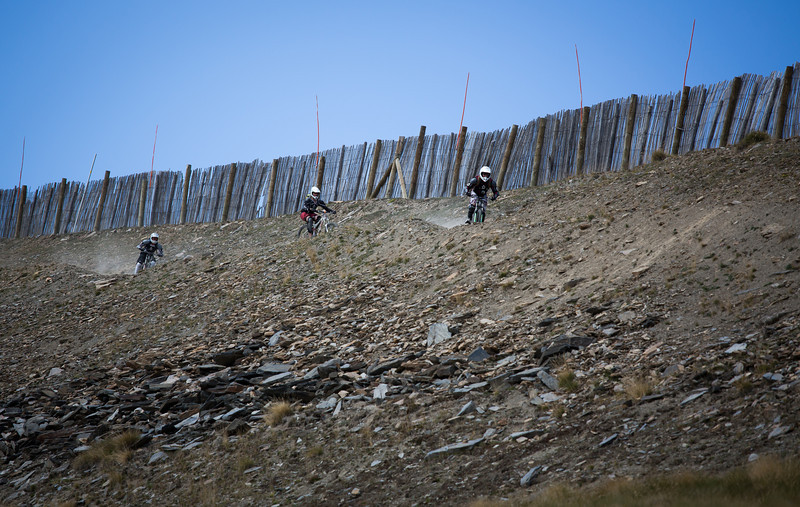 At the top of Granvalira Bike Park three riders chase each other down hill