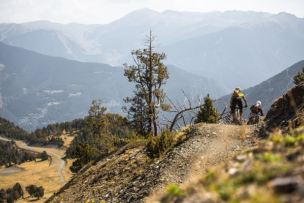Two riders zoom down from the top of Vallnord bike park i Andorra