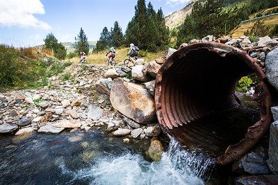 Stream crossing At the bottom of the bike park the riders roll back in to town