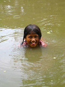 girl swimming in an angkor pool