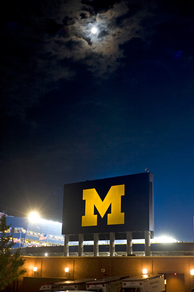 The moon peaks through the clouds over Michigan stadium during U-M's first-ever night game on Sept 10, 2011.  (Mark Bialek/Special to the Det News)