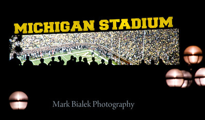 Fans are silhouetted on the scoreboard during U-M's first-ever night game on Sept 10, 2011.  (Mark Bialek/Special to the Det News)