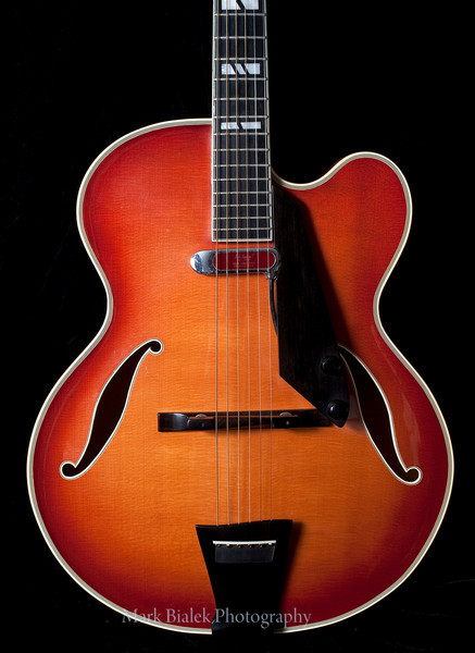 """A rare 1978 D'Aquisto New Yorker, 17-inch arch top guitar with brass strings.  It has a spruce top with a subtle sunburst finish, the first such finish of its kind made by D'Aquisto.  Under 300 of this particular guitar were ever made, making it worth around 70 to $80,000 at current time.  D'Aquisto guitars were played by musicians such as Paul Simon and Joe Pass.  The owner of this guitar noted how D'Aquisto was a master at """"bringing out the sound,"""" distinguishing it from other custom made guitars.  (Photo ©Mark Bialek)"""