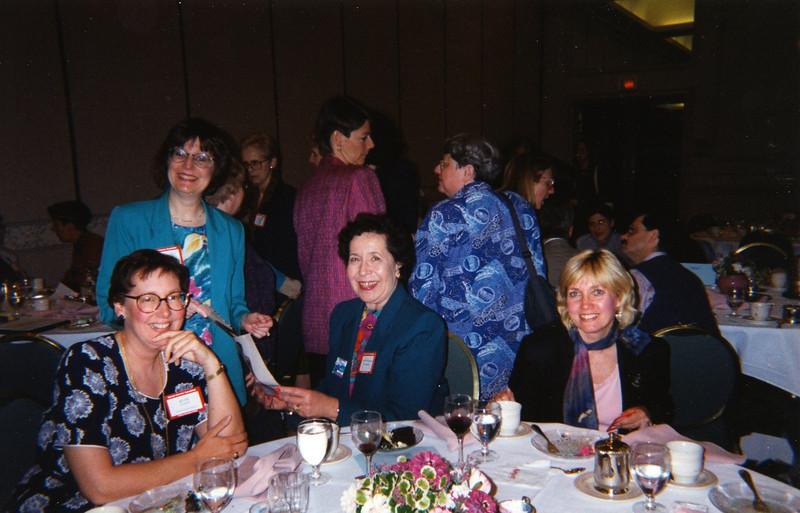 Ruth Kampen, Kay Delap (standing), Michelle LeMonde-McIntyre, and Tanya Mollenauer.