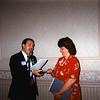 Ray Niro passes the gavel to Elizabeth Winiarz.