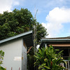 35 ft tower with 10 ft. pole extension, side mounted on the house. The avocado tree provides a screen, and nobody has complained about the tower.