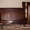 Bed #3.  Sleigh bed, shows heaboard & footboard, and side rails.   Footboard of bed #4 is behind.