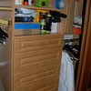 As you open the closet doors it is all organized with drawers, shoe racks, shelves and hanging areas.
