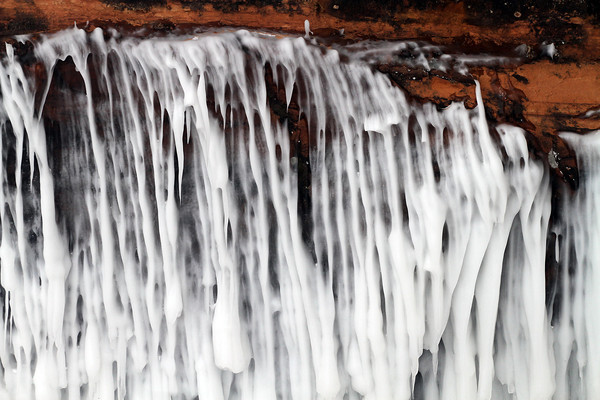 Pat Christman<br /> Lake Superior's waves are frozen in time on the wall of one of the caves.