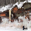 Pat Christman<br /> The ice is tainted brown by the Lake Superior brownstone that forms the cliffs. The caves stretch for more than a mile along the lakeshore.
