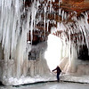 Pat Christman<br /> A child peers through a hole in a cave as ice clings to its walls and ceiling in the Apostle Islands National Lakeshore in northern Wisconsin. The caves, formed by Lake Superior's waves along the north facing shore, are accessible on foot this winter for the first time since 2008.